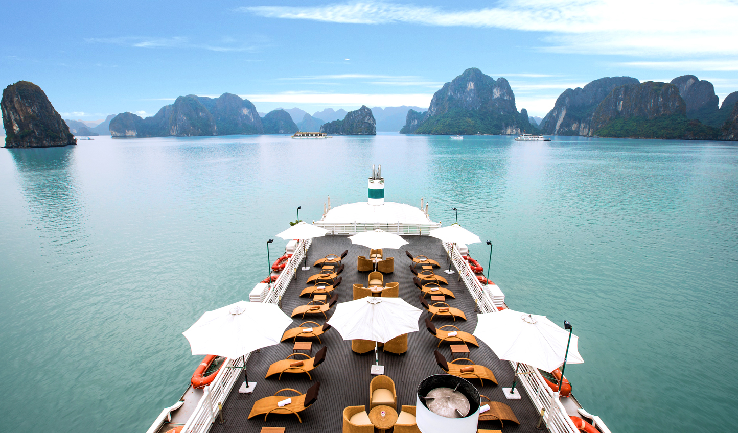 Marvel at the beautiful scenery of Halong Bay from the comfort of the sundeck
