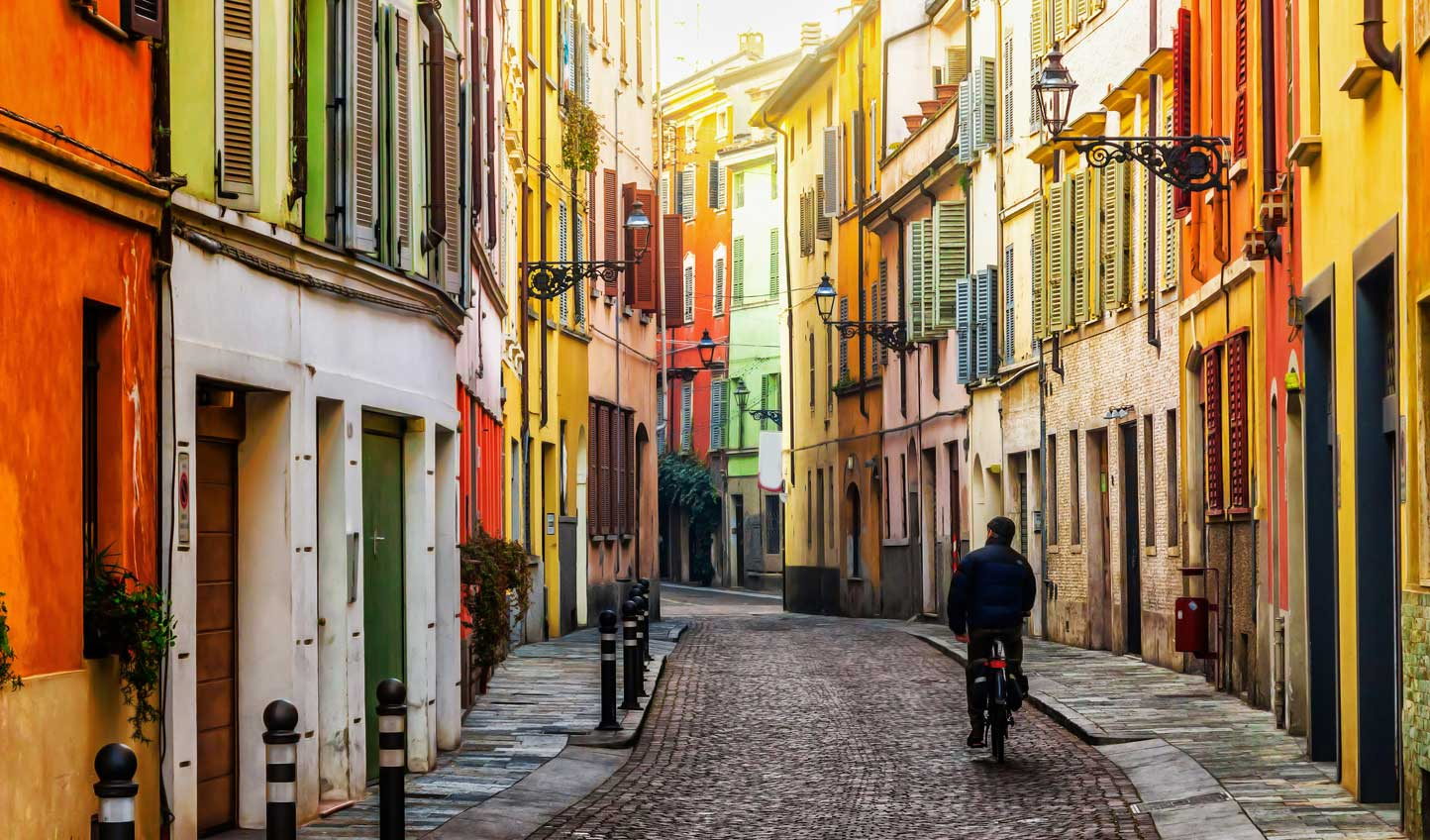 Wander through brightly coloured streets in Parma