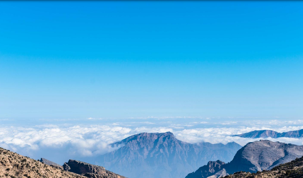 Take in the spectacular Al Hajar Mountain range