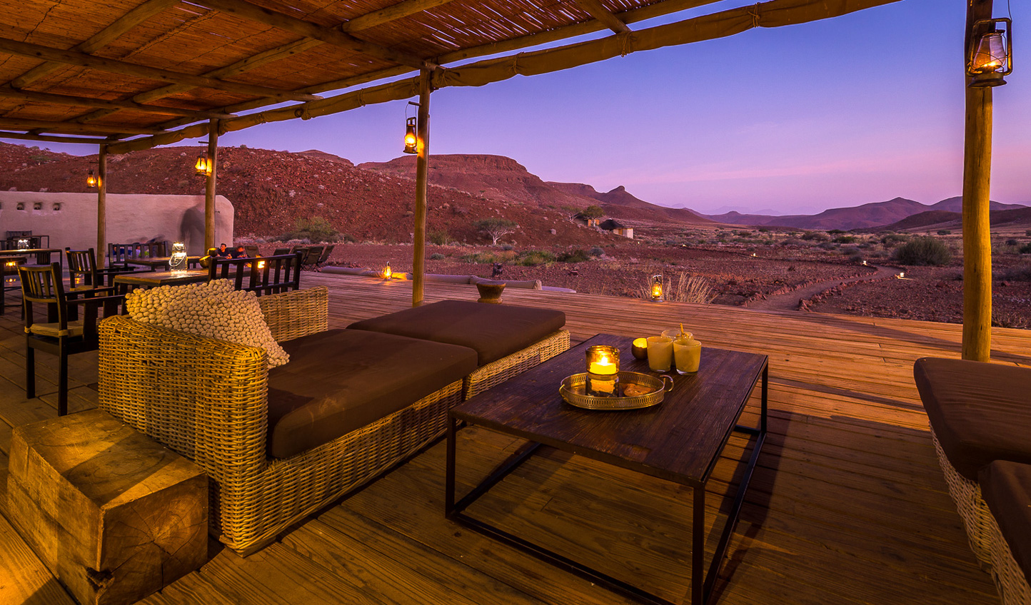 Curl up with an aperitif and watch day fade to night at Damaraland Camp