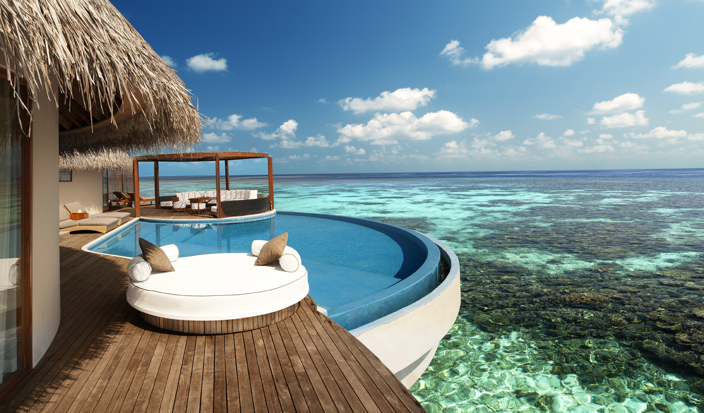 Look out over tropical reefs from your infinity pool