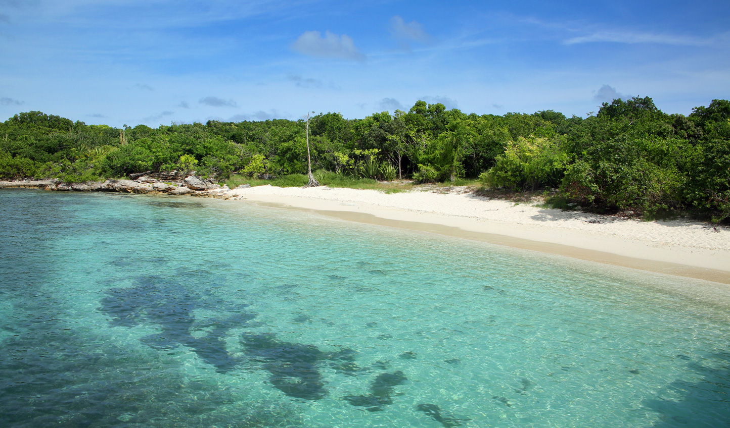 Escape to the uninhabited Green Island and walk its sandy shores in total seclusion