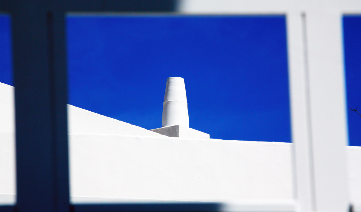 Expect typical white Greek buildings set against a clear blue sky