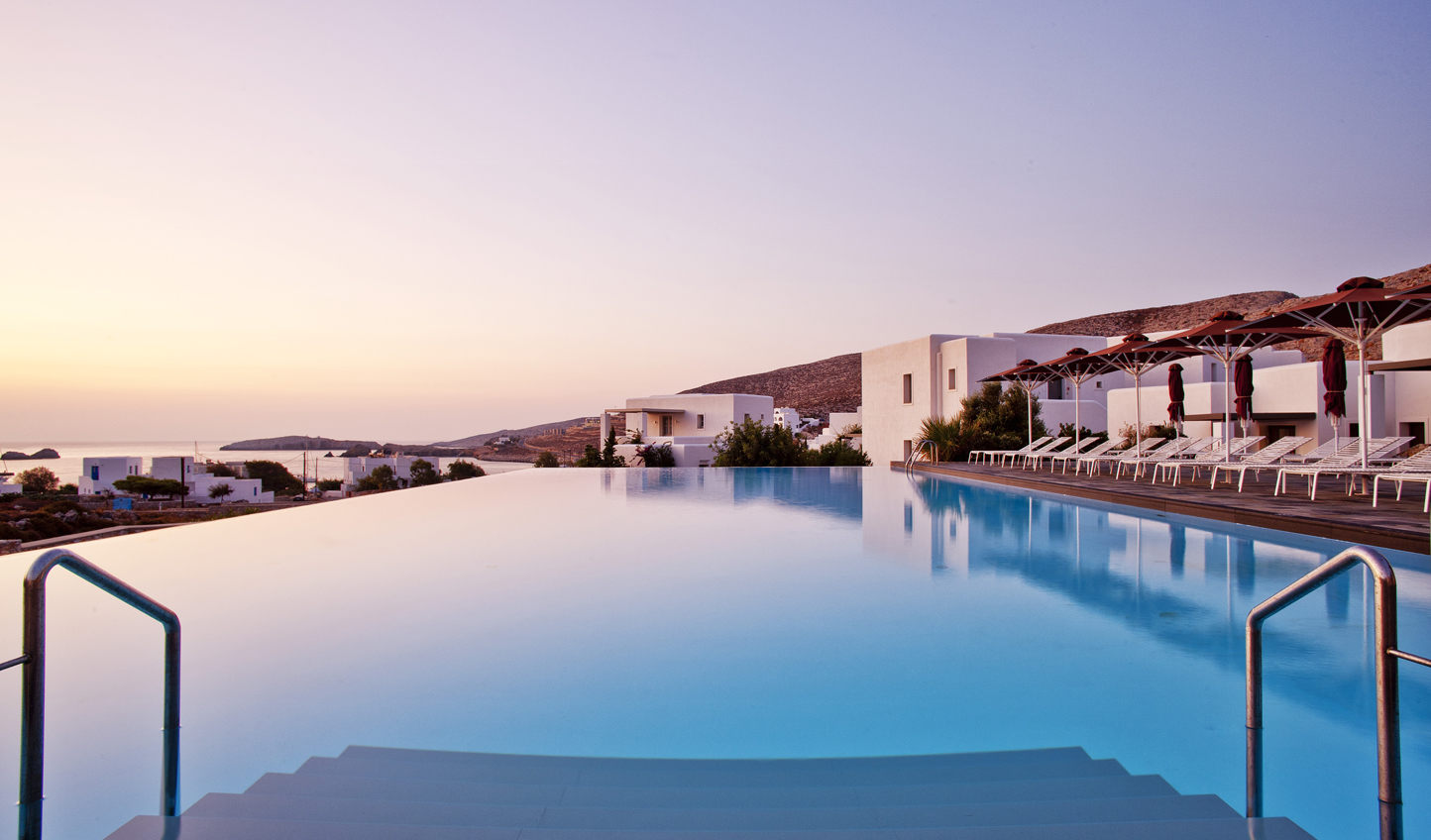 Watch as the sun dips down below the island of Folegandros