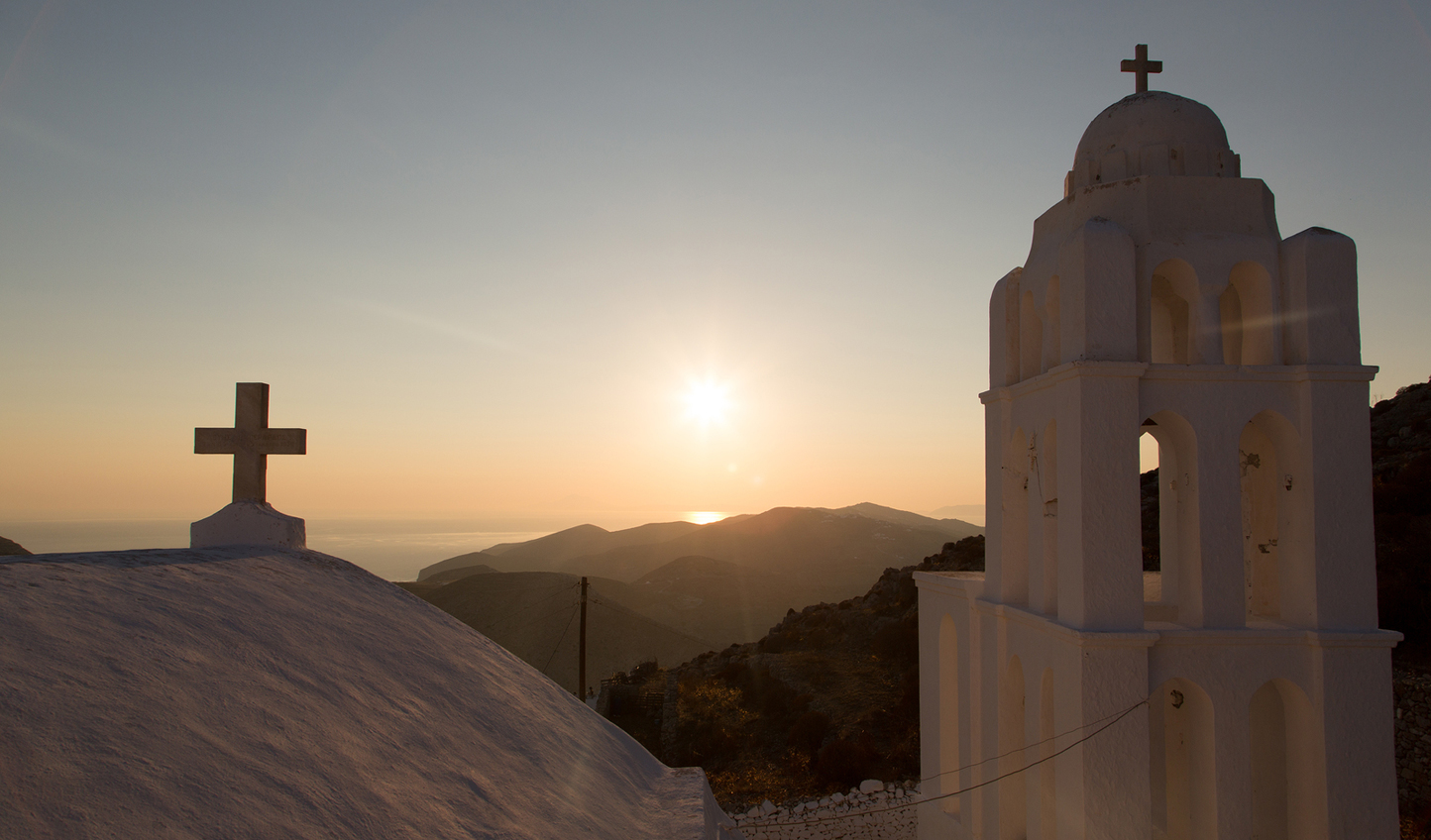 Watch the sunrise over the hills of Chora
