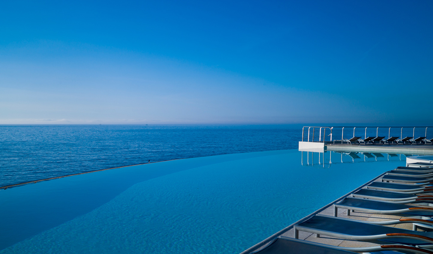 Gaze out over endless blues as you relax in the infinity pool