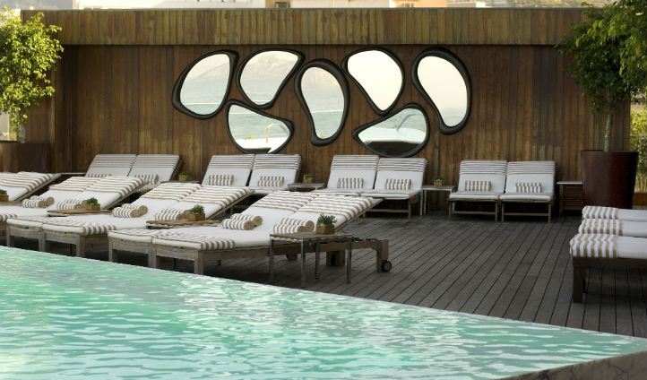 Admire the elegant designs around the rooftop pool