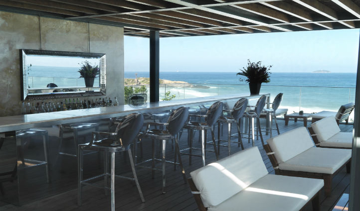 Admire the stunning views of the glistening ocean from the rooftop bar