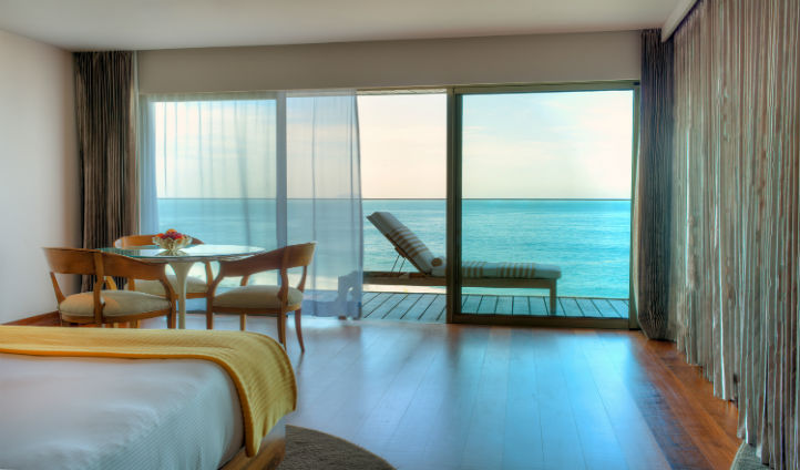 Gaze across the glistening ocean from your luxury suite