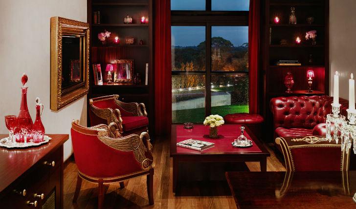 Passionate reds and dark wood floors