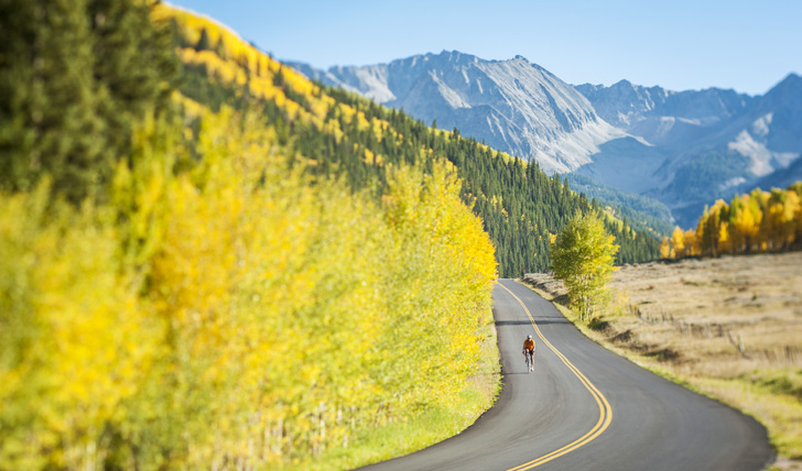 A bicyclist on Castle Creek Road in Aspen, Colorado.