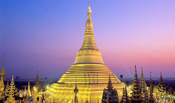 Yangon's Shwedagon Pagoda illuminated at dusk