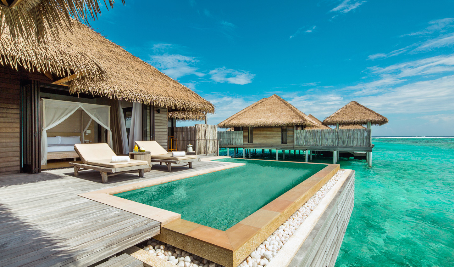 Step straight from your Water Villa into the lagoon