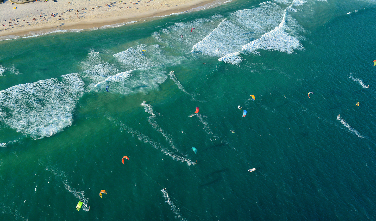 Head into the waves for a spot of kite surfing