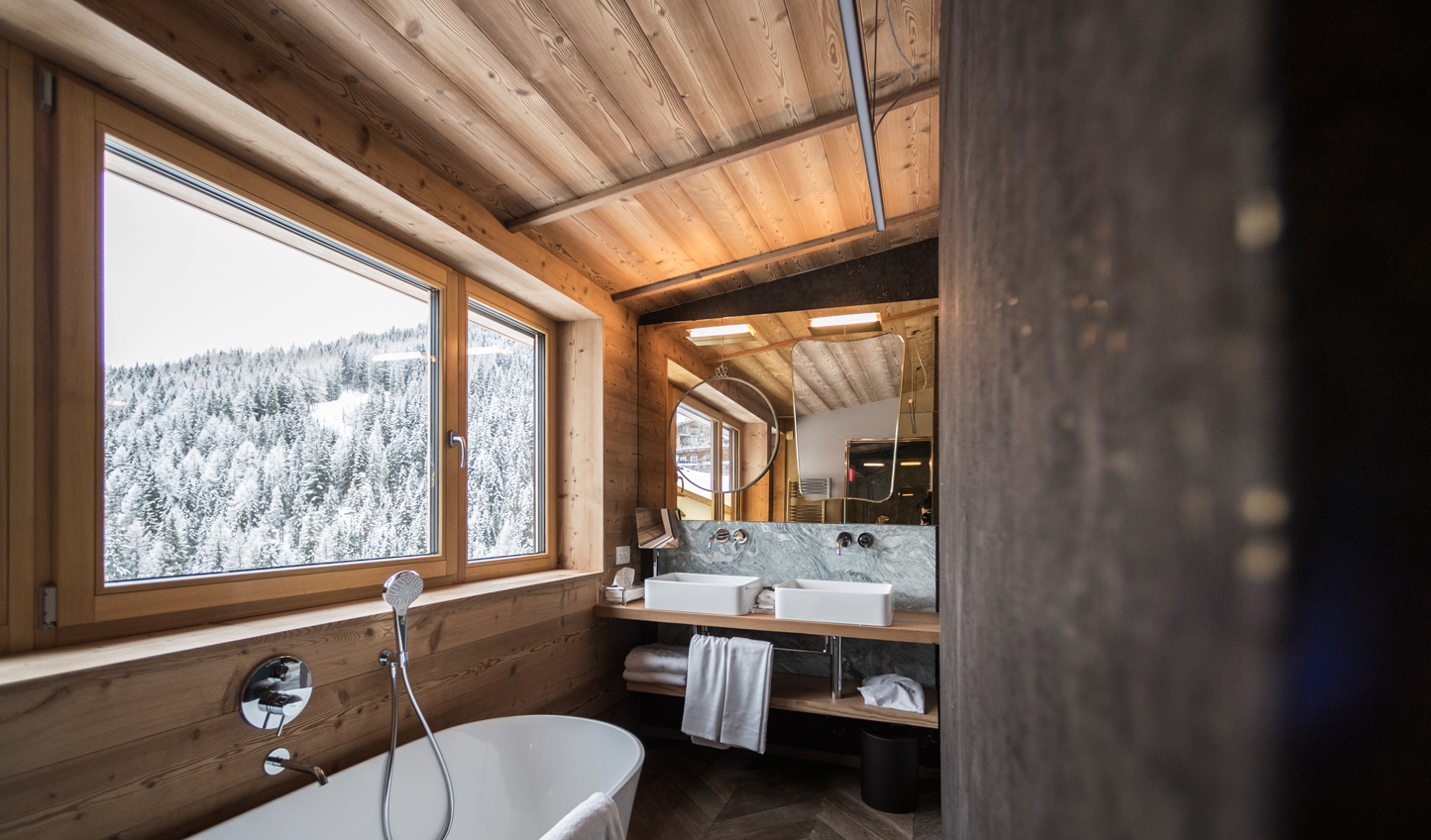 Indulge in a warm bath overlooking the Dolomites