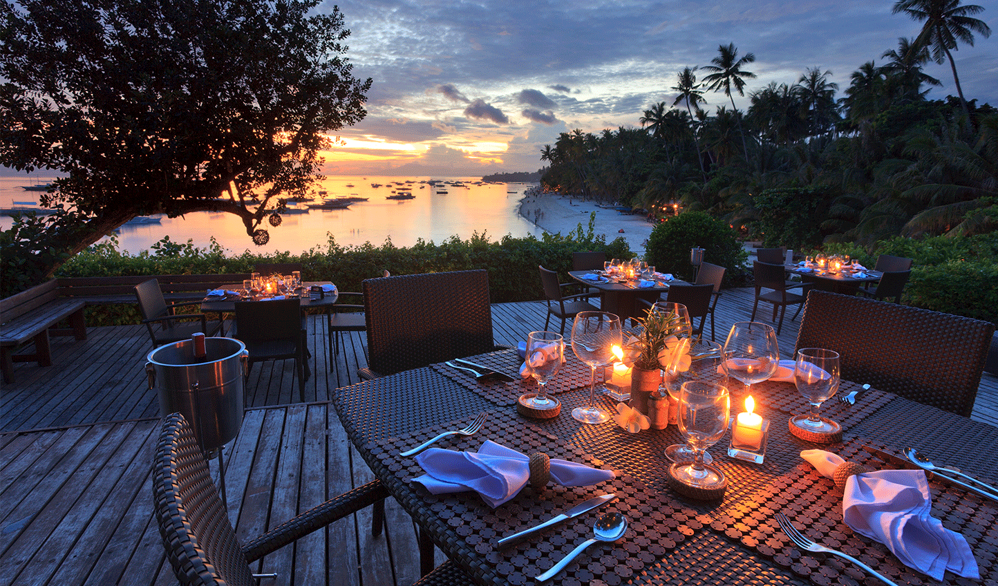 Dine al fresco as the sun sets in the distance