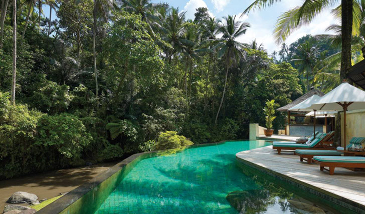 Luxury hotel pool at the Four Seasons Bali at Sayan, Ubud, Bali, Indonesia