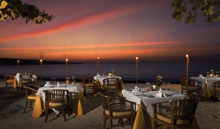 Luxury hotel beach dining at Jimbaran Puri, Bali, Indonesia
