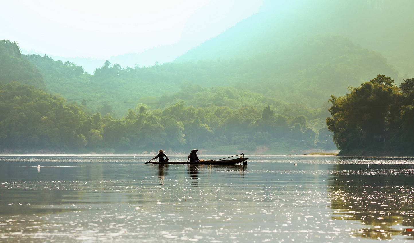 Head to Laos and be guided down the Mekong River in a traditional tailboat