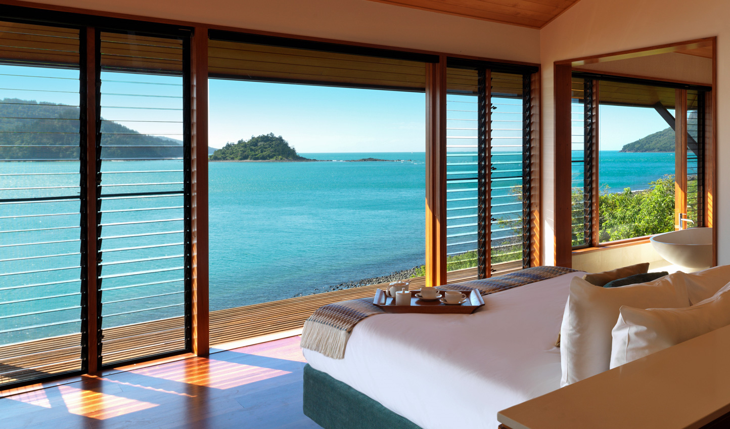 Look out over endless blue waters from Qualia