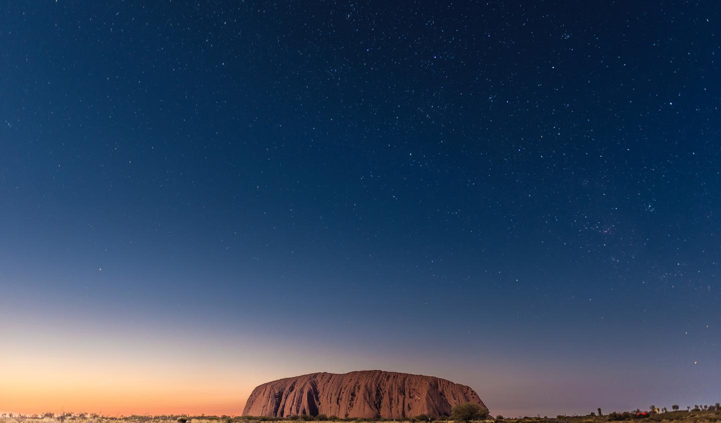 See the stars shine above Uluru