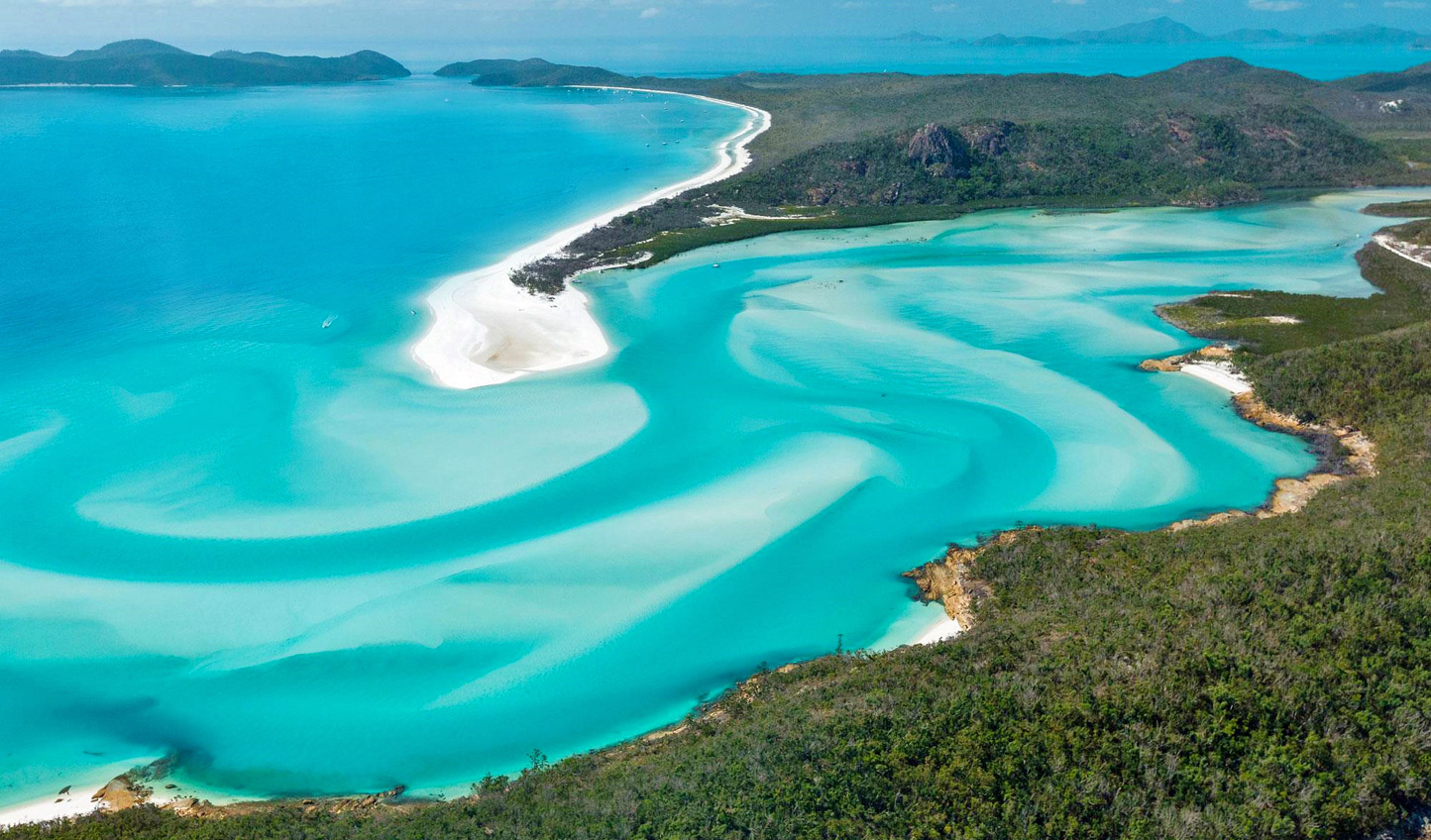 The swirling blue hues of the Whitsundays