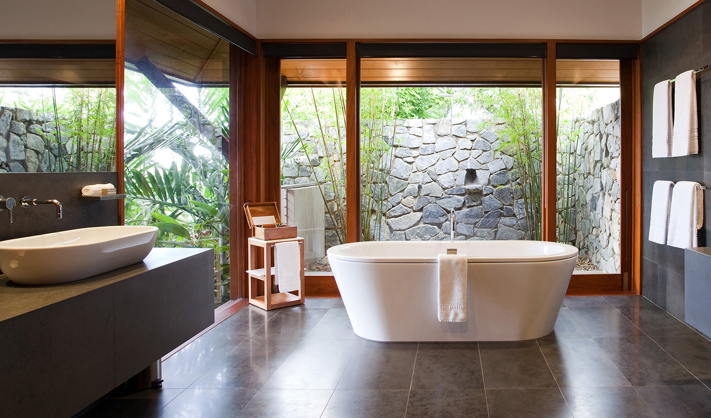 Sink into the tub and enjoy the tropical views