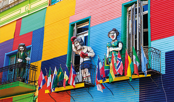 Opera puppets on the balcony of La Boa's colourful houses | Buenos Aires