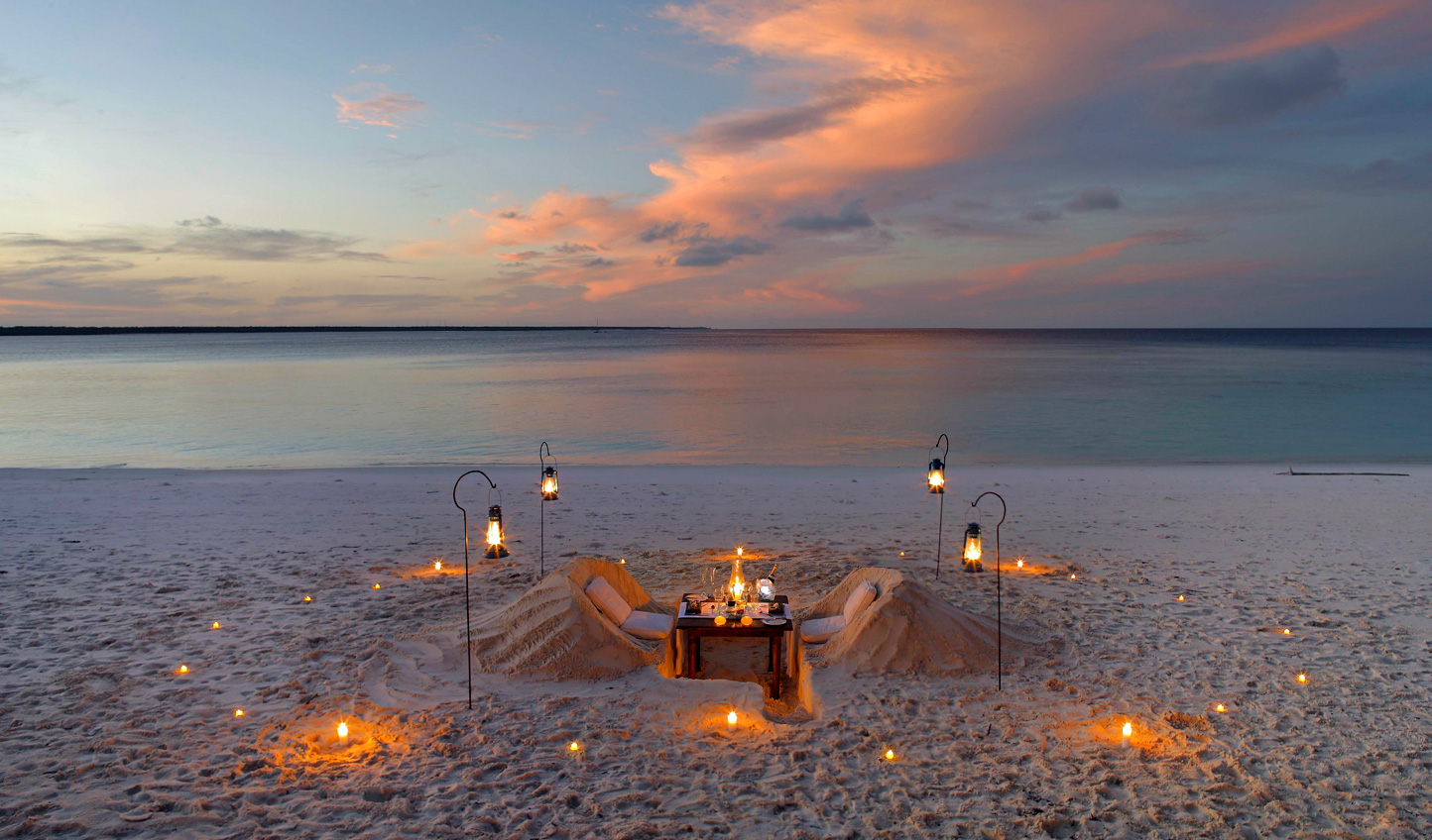 Sink into the sand over a private dinner for two