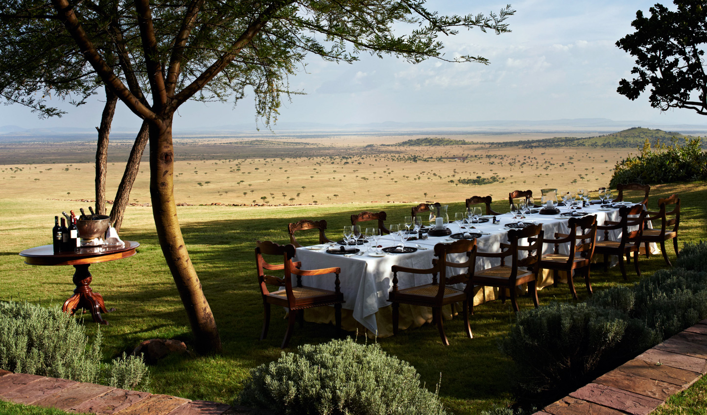 Dine out at Singita Sasakwa and admire the never ending views