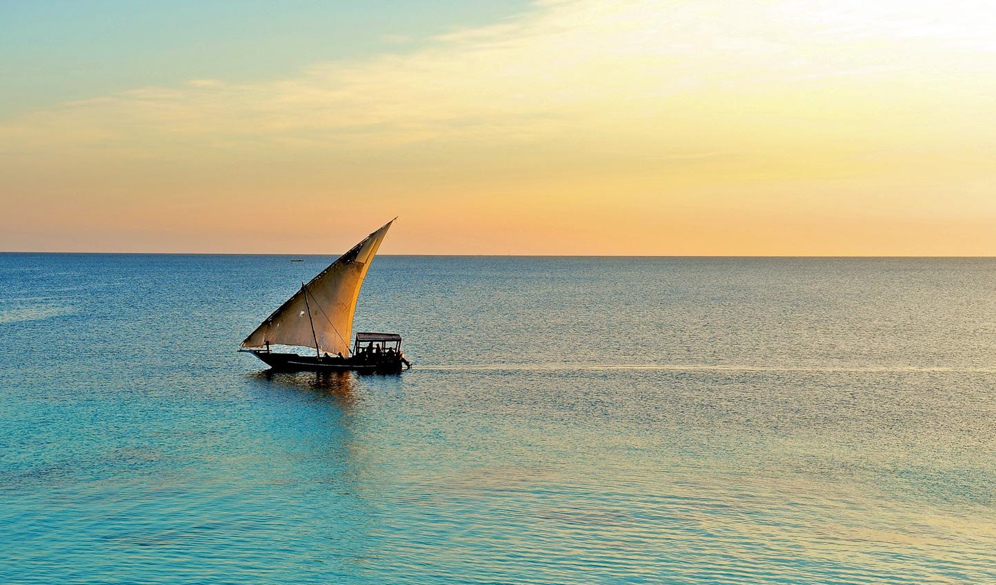 Set sail around Mnemba Island at sunset