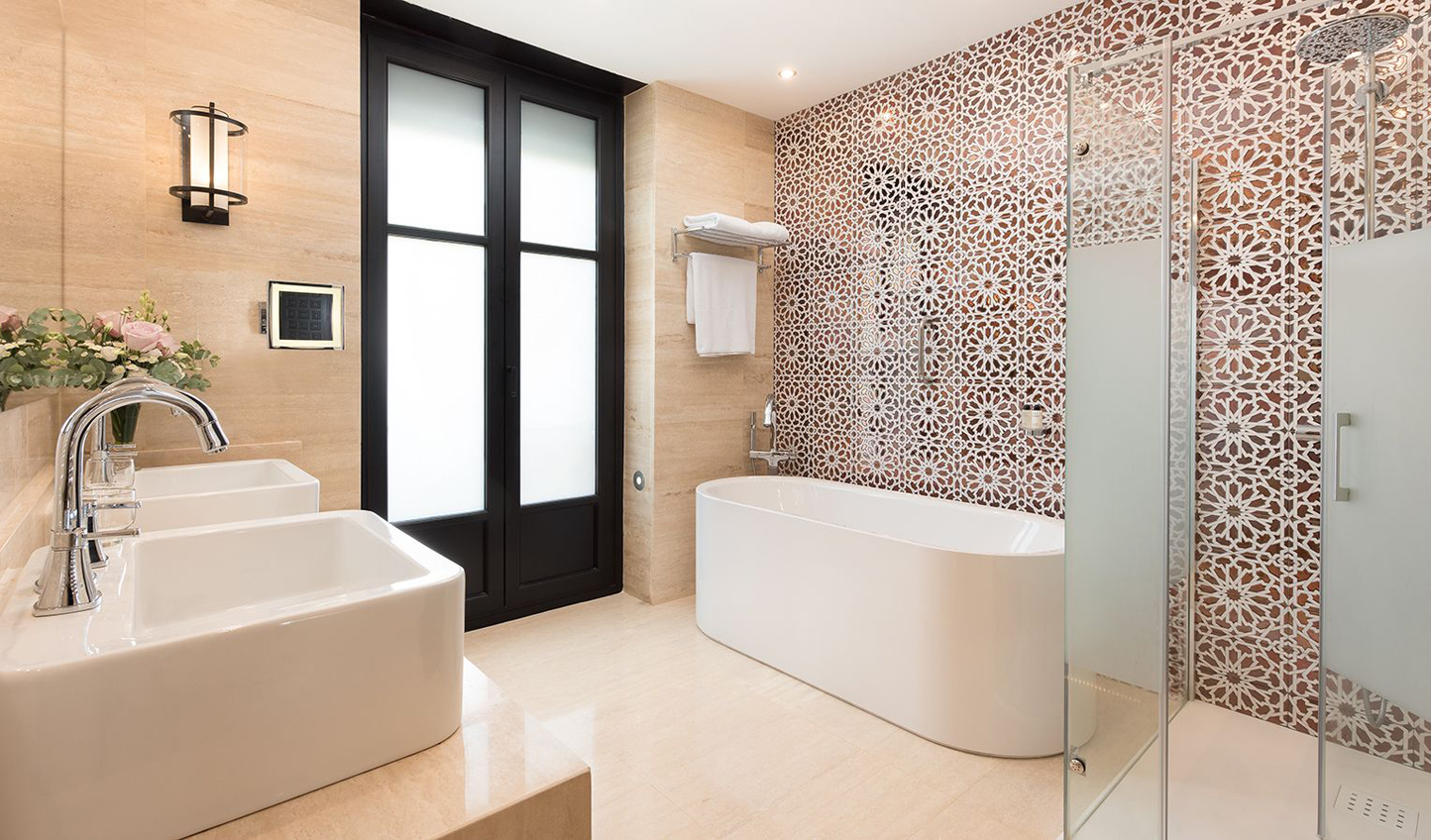 Intricate tiling runs throughout the hotel and extends into the bathrooms
