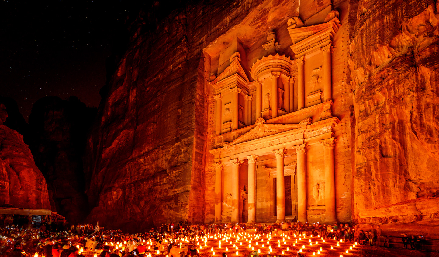 See Petra by night as it is lit up by thousands of candles
