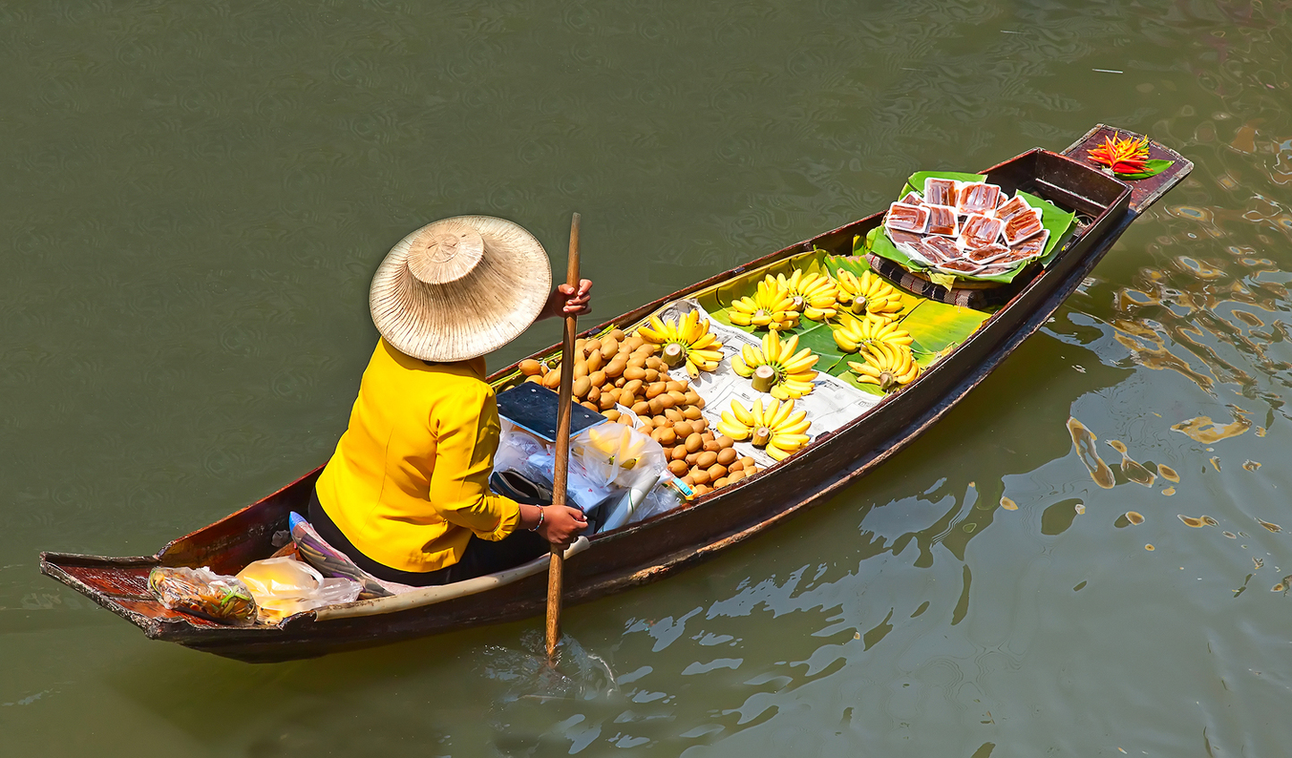 Discover floating markets full of local delicacies