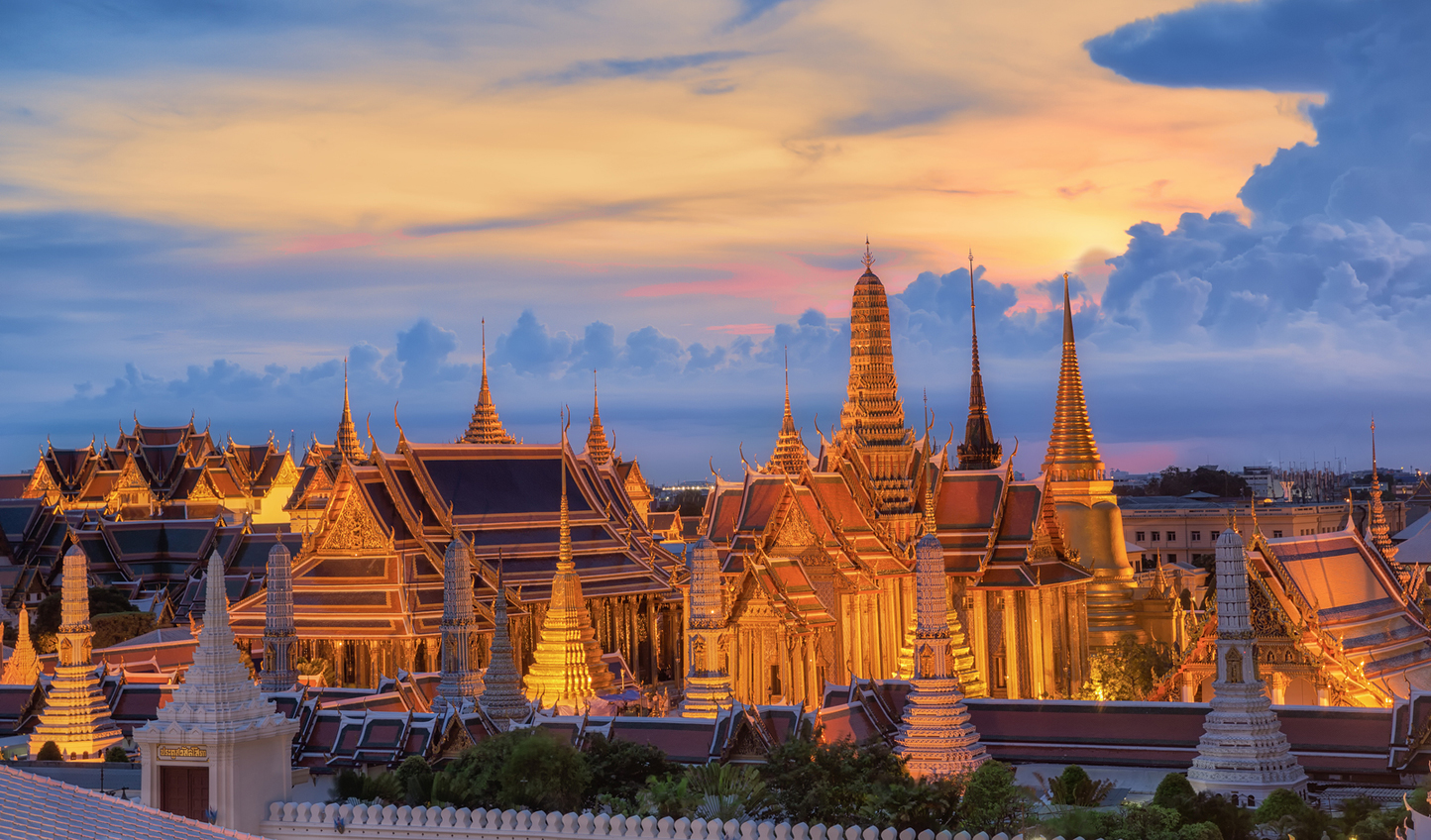 Marvel at the wonder of the Grand Palace at sunset
