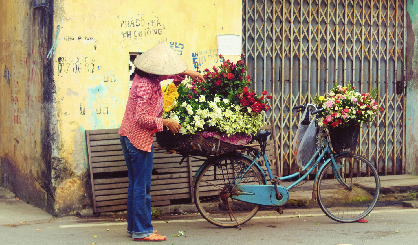 A flower vendor in the streets of Hanoi