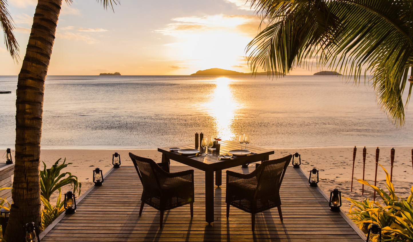 A romantic spot for dinner as the sun sets and the waves lap the shore