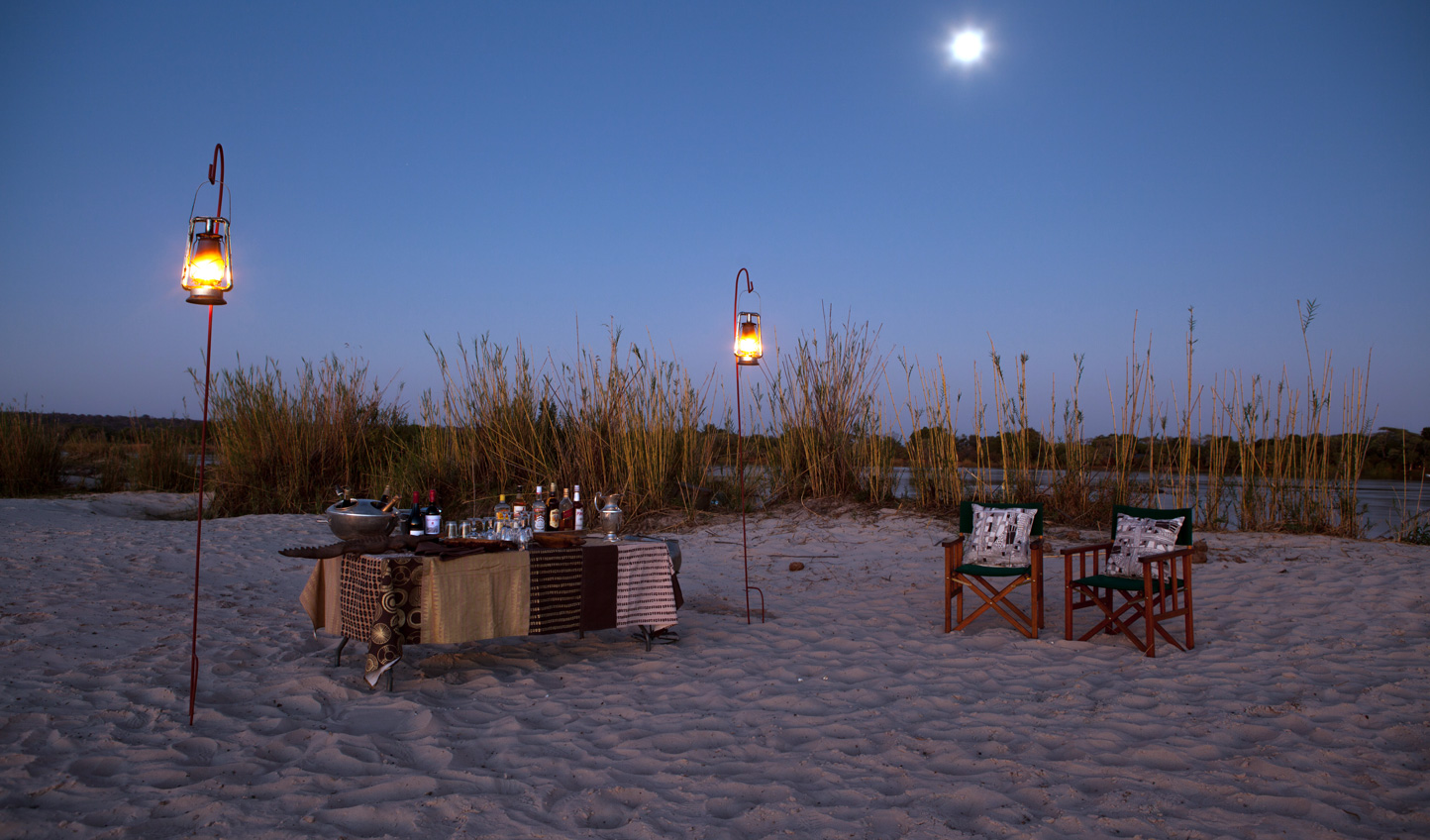Enjoy a private boma dinner and the sand bar