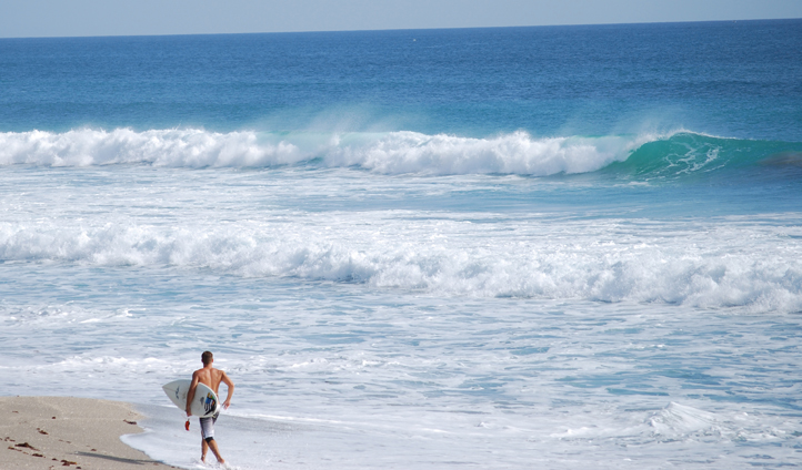 A surfer on Jupiter Beach