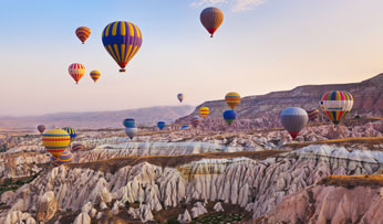 Hot air balloons over Cappadocia , Turkey
