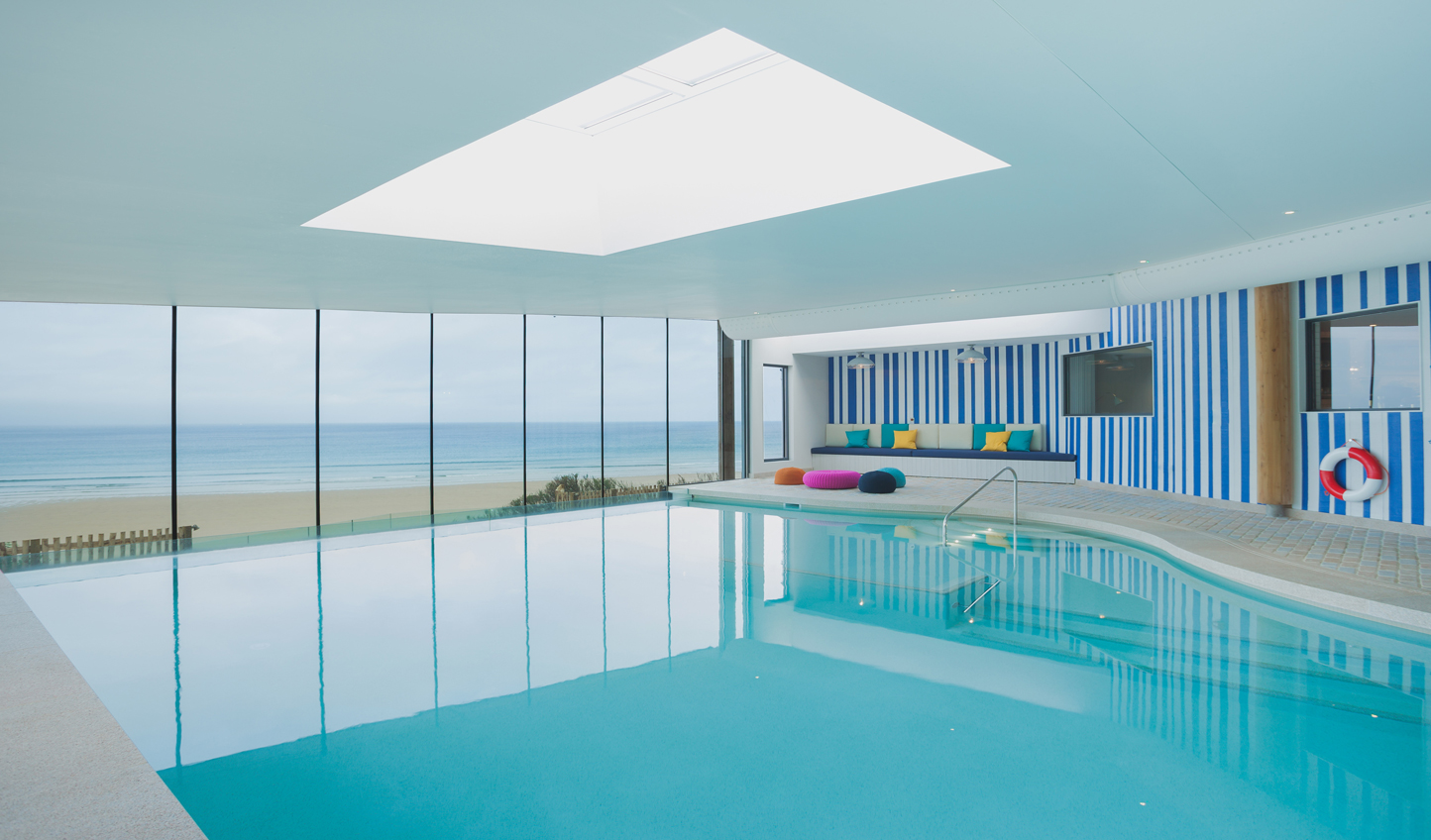 Swap the sea for the glass-fronted indoor pool