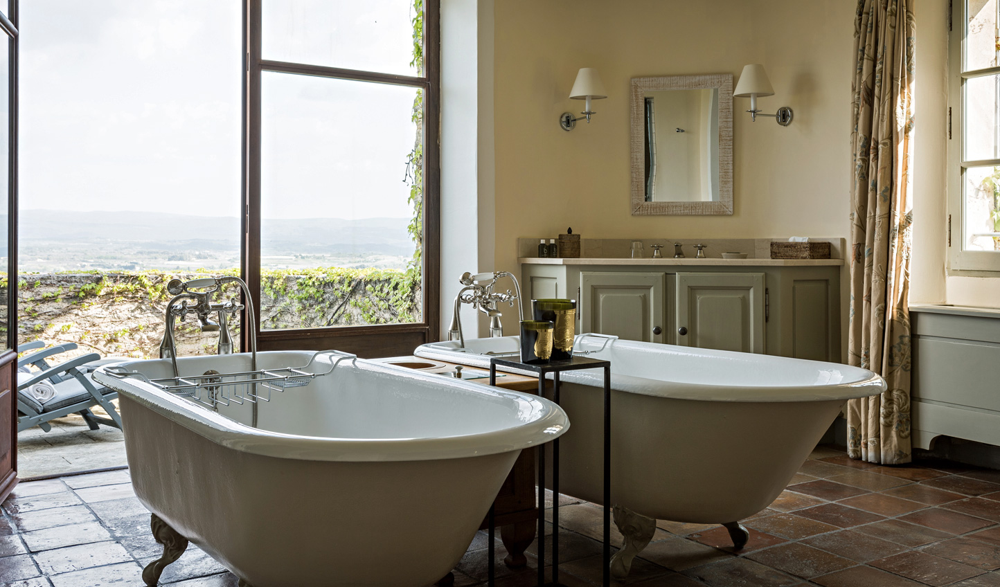 Slip into twin soaking bathtubs and gaze out over the view