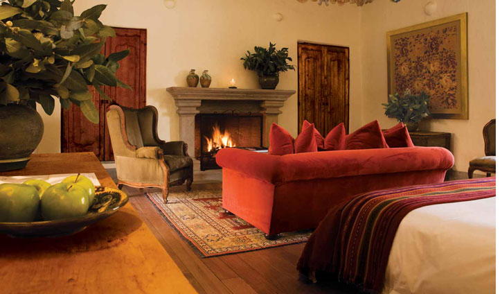 Relax by the fire in your opulent suite