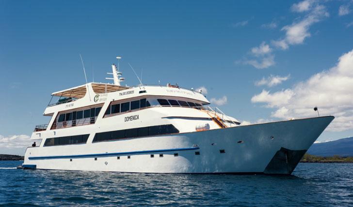 The luxurious MY Grand Odyssey Yacht sailing across the Galapagos archipelago.