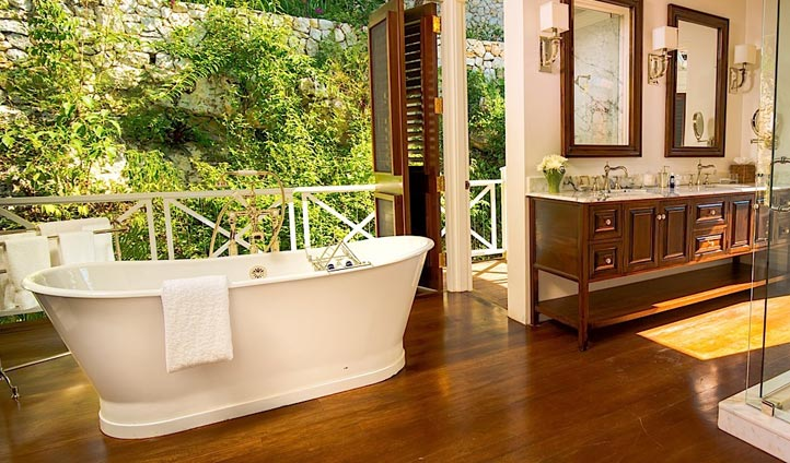 Luxury bathtubs overlooking dense foliage