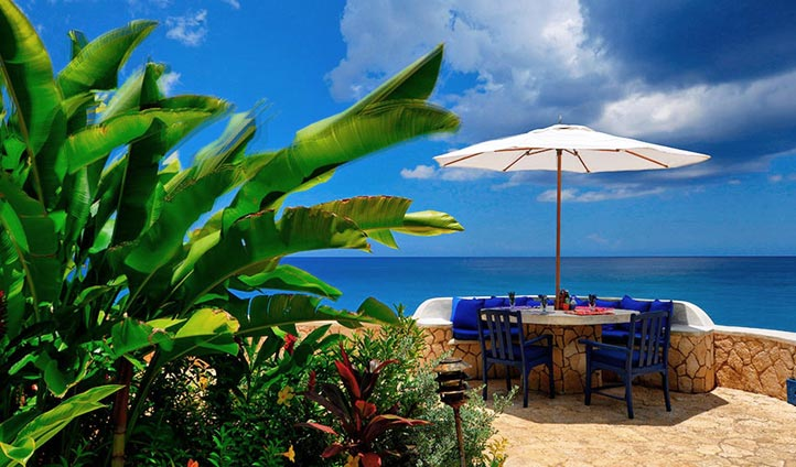 Dine overlooking the Caribbean Sea
