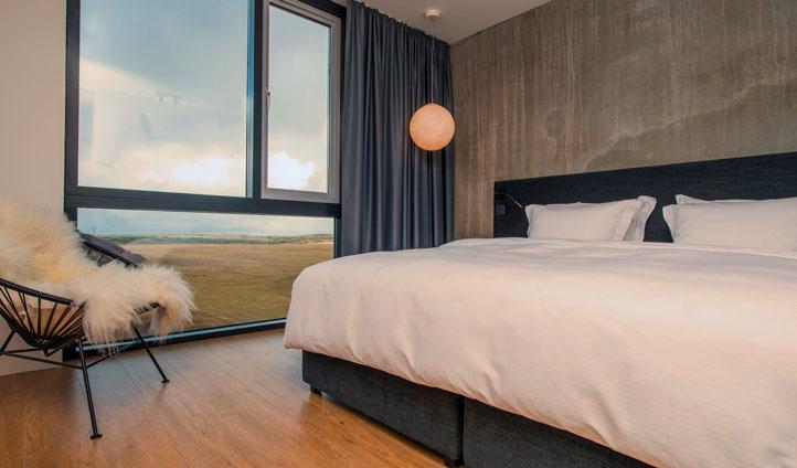 Gaze across rolling hills from your room's floor to ceiling windows