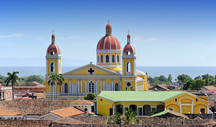 A cathedral overlooks the sea in Grenada, Nicaragua