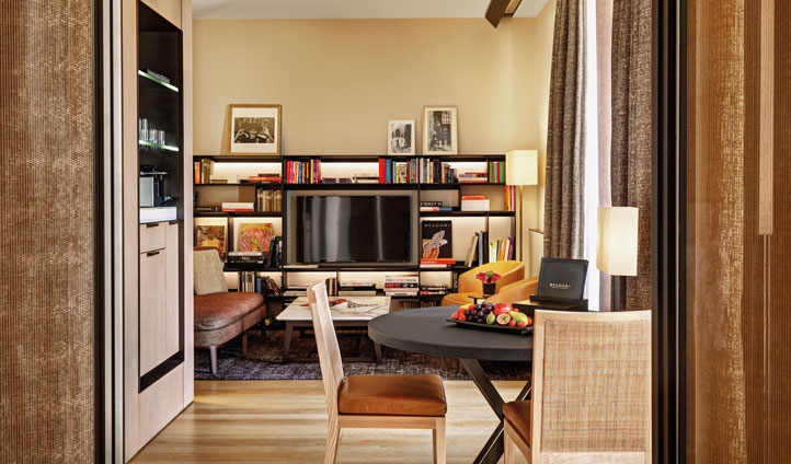 Spacious suites provide seating areas, tables, TV and a bookcase