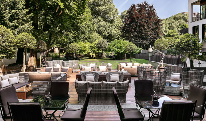 Unwind with a glass of champagne in the hotel's lovely garden